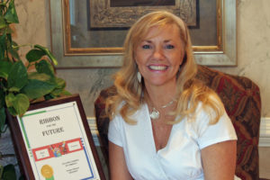 Owner Vicky Bates with Community leadership award